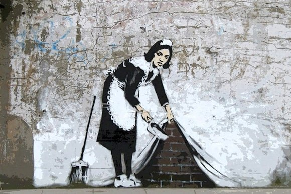 banksy french maid revealing wall