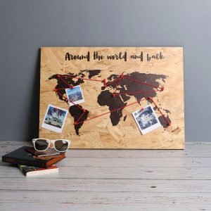 wooden world map with markers