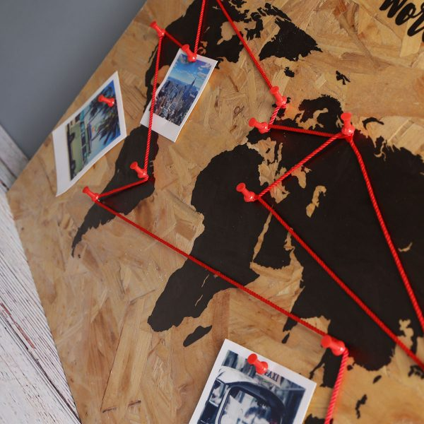wooden print world map with destination markers