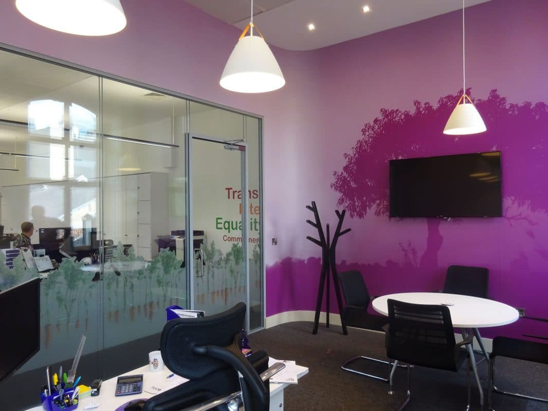 purple directors office with tree wall art