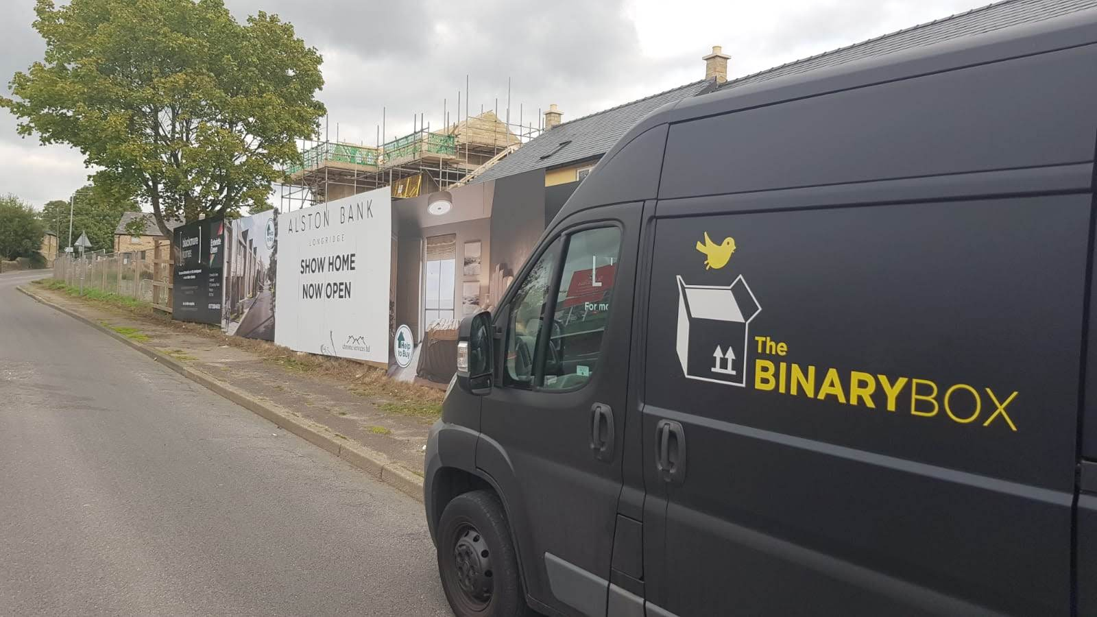 binary box van with logo outside project