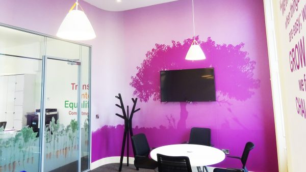 purple office wall art branding with tree