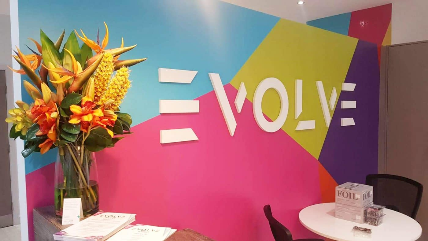 Flat cut branding and wallpaper feature at Evolve Academy.