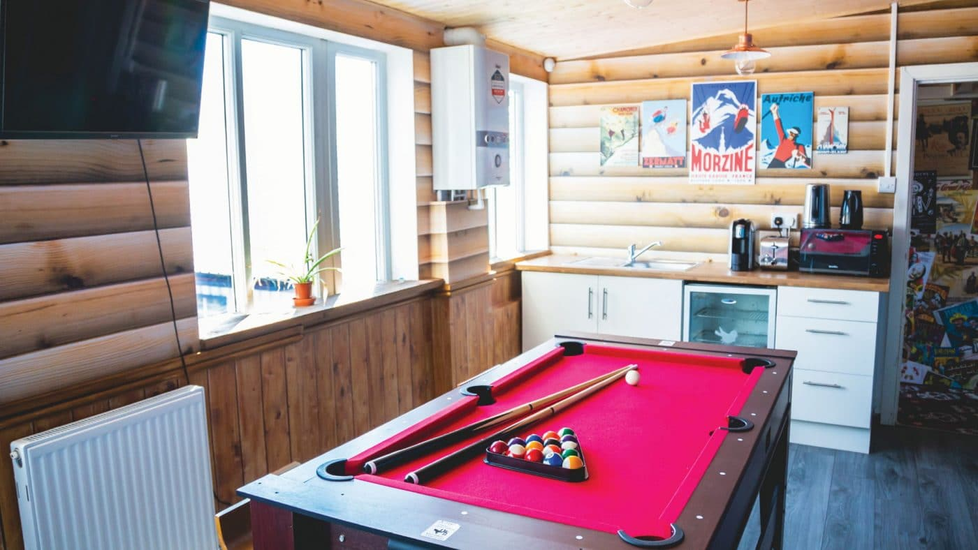 Pool Table with Ski Chalet themed wall graphics